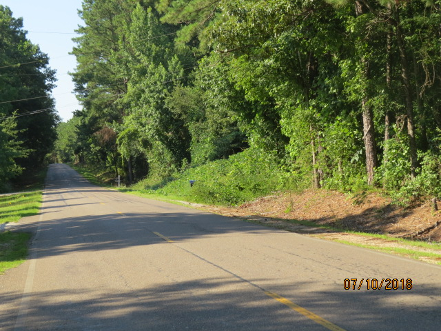 The property fronts for  3/4 miles on a paved county road (property on the right)