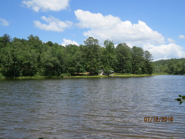 A view of the cabin from across the lake