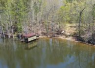 LAND, LAKE, HARDWOODS, AND HOME SITES
